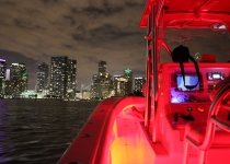 Sea Vee 34 Center Console at night with the Miami Skyline